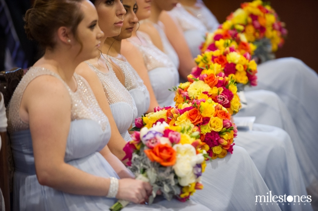 Seven bridesmaids with colourful bouquets