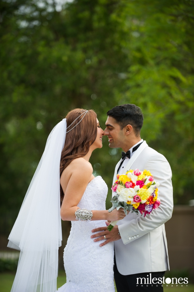 Bride & groom kiss natural photography