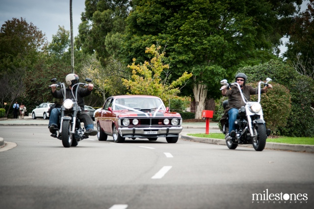Bride travelling in 351-GT to the church with motorcycles