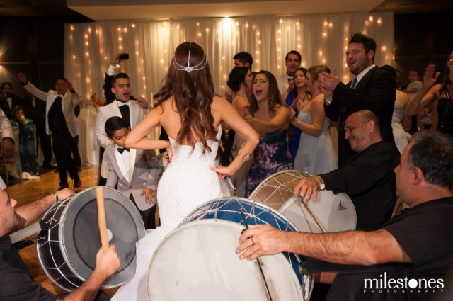 Bride dancing to the drums