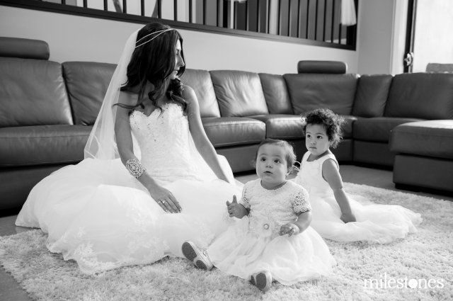 Bride with flower girls sitting rug