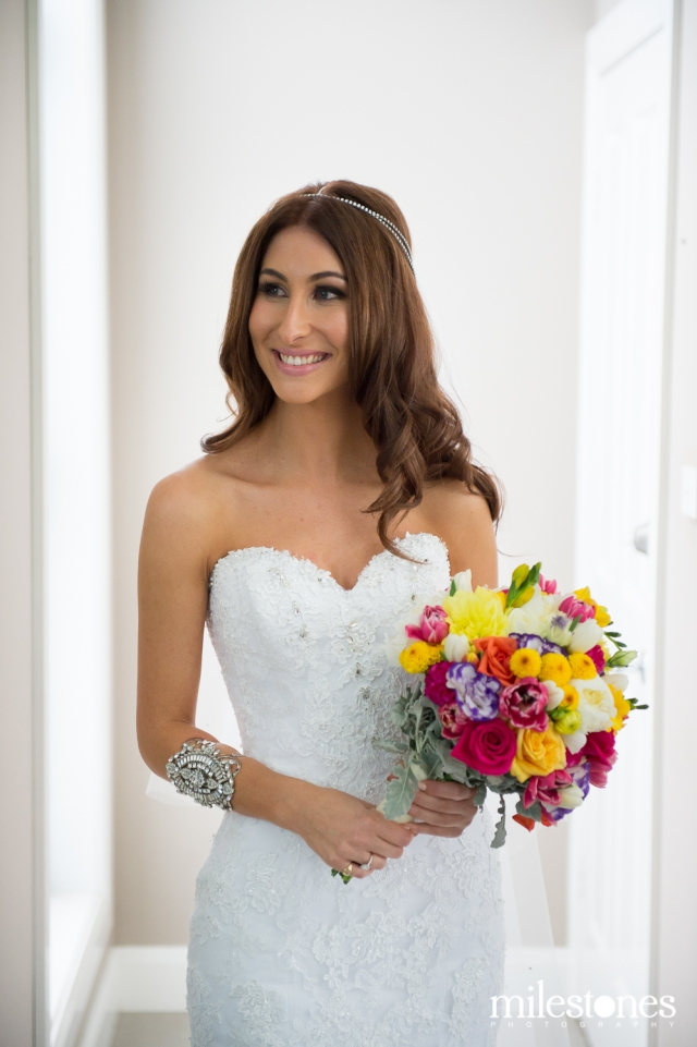 Bride with colourful posies bouquet