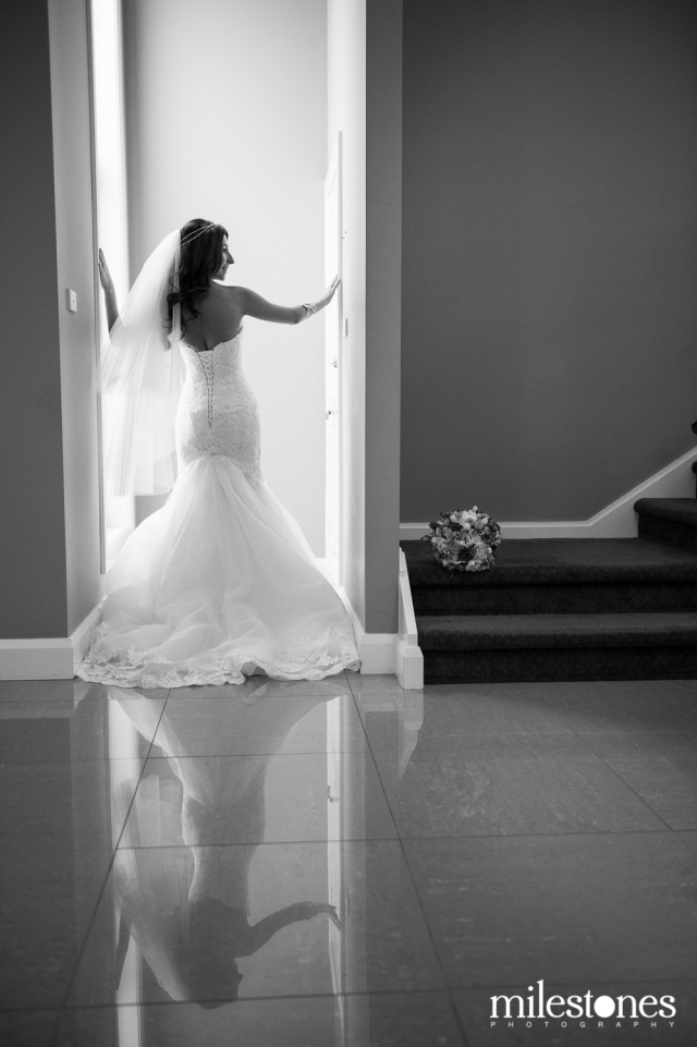 Bride in doorway reflection on tiles